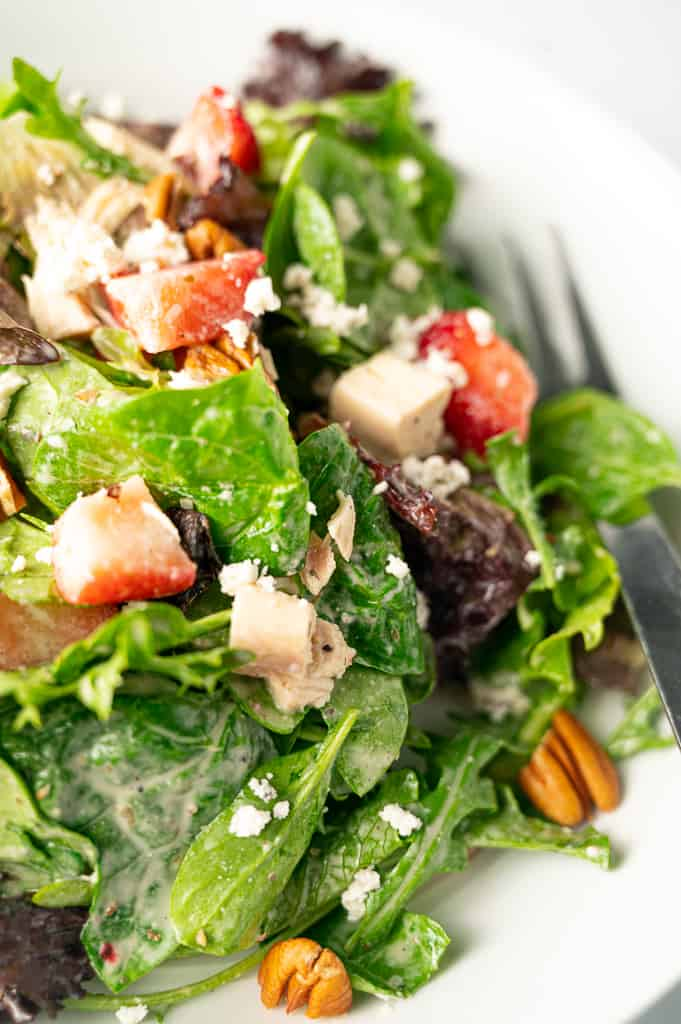 Lettuce with chicken strawberries pecans and goat cheese