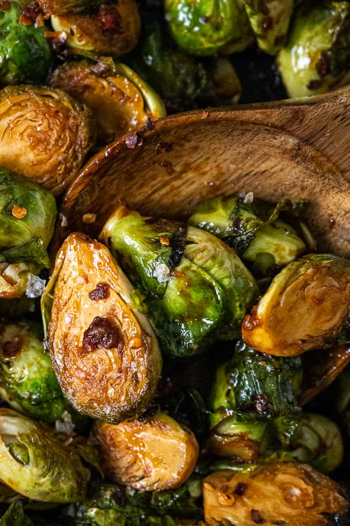 Close up photo of Gochujang brussels sprouts with pancetta in a pot