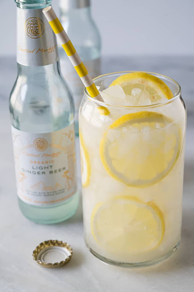 Cocktail with lemon and ginger beer.