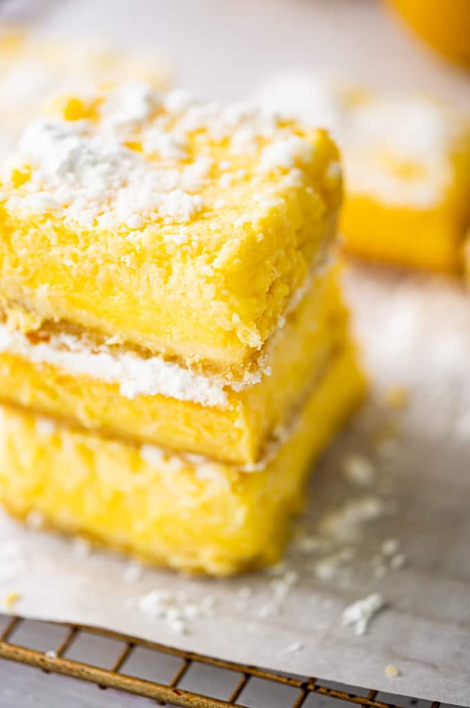 Lemon bars stacked on corner shot