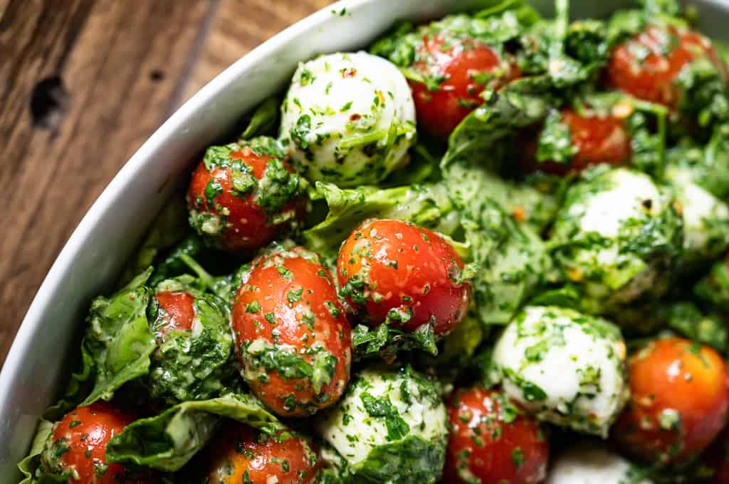 Mozarella, tomatoes and basil together.