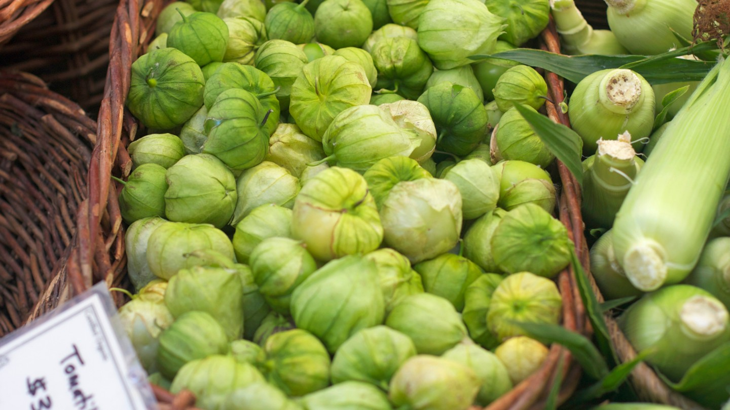 Tomatillos in a basket at a market