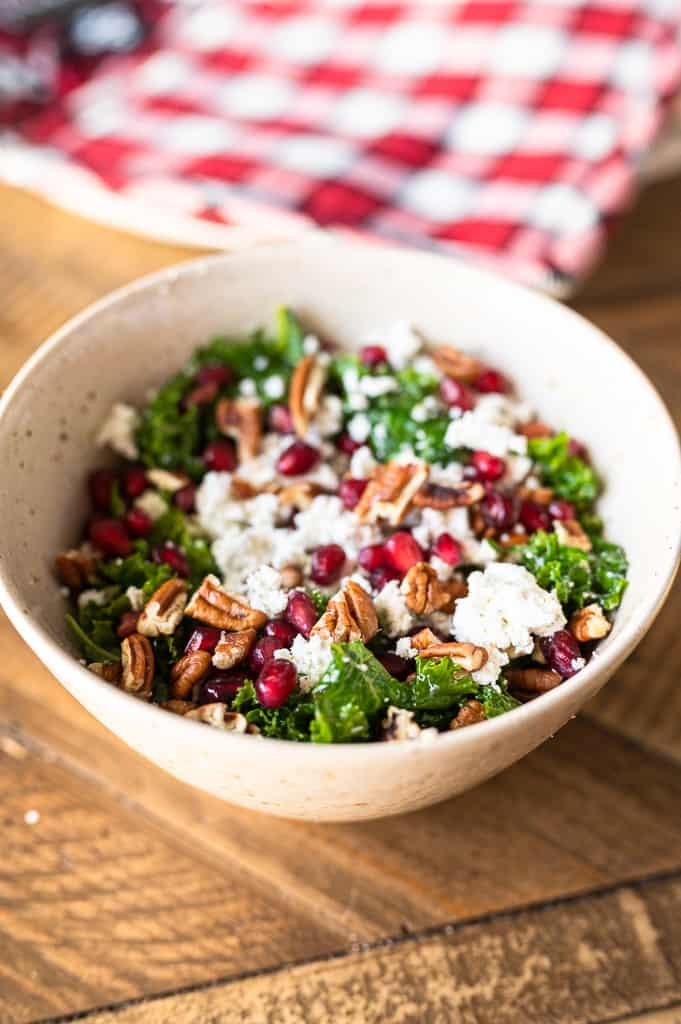 Massaged kale salad on a dining room table in a bowl