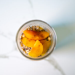 oats and peaches combined together for overnight oats