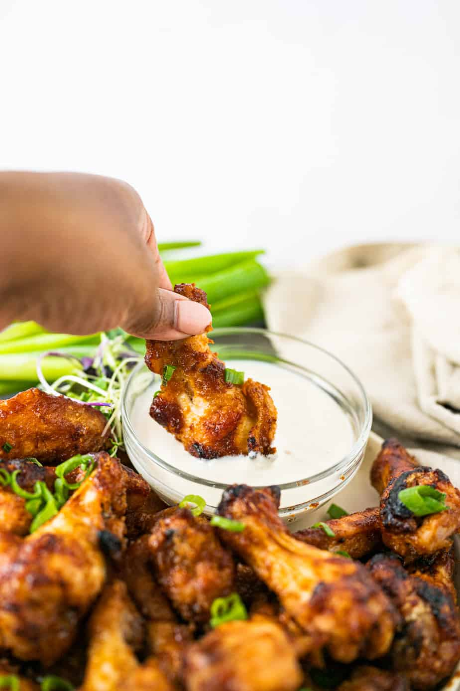 Miso wings dipped in ranch dressing